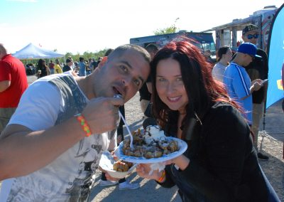 happy couple eating funnel cakes
